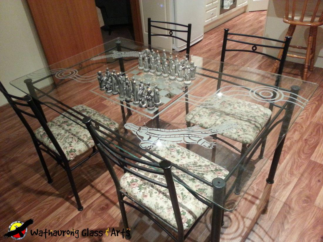 Engaved kitchen table with chess board and platypus