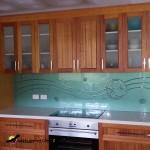 Wathaurong green splashback with a butterfly